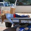 Girl laying on tailgate — Stock Photo #11452437