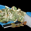 Money in dust pan — Stock Photo
