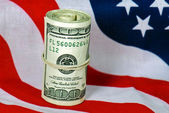 Wad of cash on flag — Stock Photo