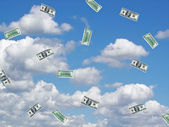 Money floating in summer sky — Stock Photo