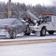 Tow truck towing a wrecked car — Stock Photo #11476336