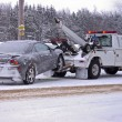 Tow truck towing wrecked car — Stock Photo #11476336