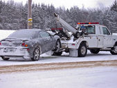 Tow truck towing a wrecked car — Stock Photo