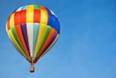 Airborne hot air balloon — Stock Photo