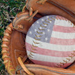 Patriotic baseball in glove — Stock Photo