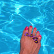 Foot in swimming pool — Stock Photo #11501227