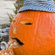 Puking Halloween pumpkin - Stock Photo
