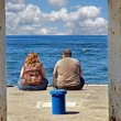 Overweight couple on pier — Stock Photo