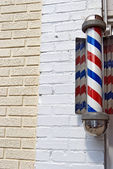 Barber shop pole on brick — Stock Photo