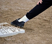 Man on first base — Stock Photo