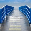 Wet pier with railing — Stock Photo #11533376