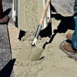 Stock Photo: Mworking with wet cement