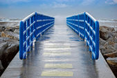 Wet pier with railing — Stock Photo