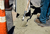Man working with wet cement — Stock Photo