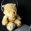 Teddy bear with headphones — Stock Photo #11557336