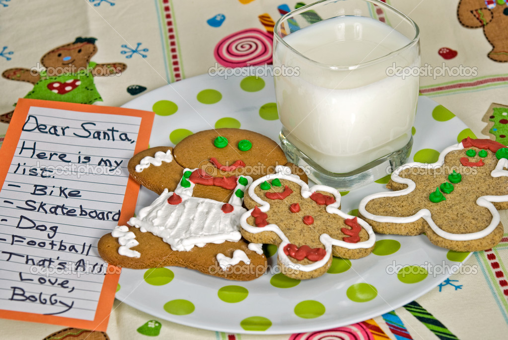 Gingerbread cookies and milk with list for Santa. — Stock Photo #11575195