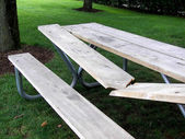 Busted picnic table — Stock Photo
