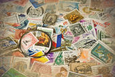 Magnifying glass on vintage stamps — Stock Photo