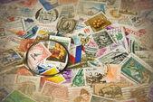Magnifying glass on vintage stamps — Stock fotografie