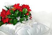 Poinsettia bouquet on bridal pillow — Stock Photo