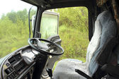 Driver's cab of the truck with the forest background — Stock Photo