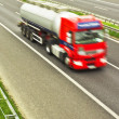 Motion blurred truck on highway — Stock Photo