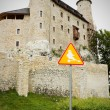 Bobolice castle and road sign with ghost — Stock Photo #12149633
