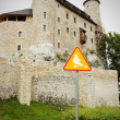 Bobolice castle and road sign with ghost — Stock Photo