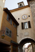 Street view with clock in the city of Annecy — Stock Photo