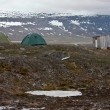 Tents and Hut in Tundra in Svalbard in the Arctic - Stock Photo