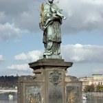 Statue of Sf. John of Nepomuk on the Charles bridge in Prague — Stock Photo #11419475