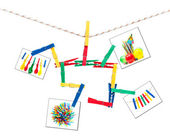 Colorful clothespins and photos on a string — Stock Photo