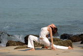 Hatha Yoga by the beach — Stock Photo