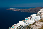 Relaxing at luxury resort in Santorini island of Greece — Stock Photo