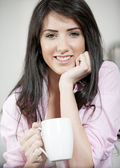 Young woman enjoying a cup of coffee — Stock Photo