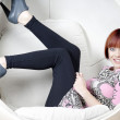Young woman sitting in chair — Stock Photo