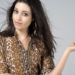 Stock Photo: Young womin animal print dress