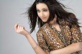 Young woman in animal print dress — Stock Photo
