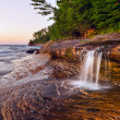 Waterfall at the beach. — Stock Photo