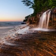 Stock Photo: Waterfall at the beach.