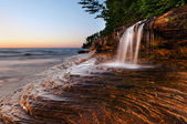 Waterfall at the beach. — Stock Photo