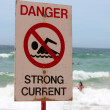 Stock Photo: Strong Current Warning Sign at Beach
