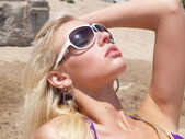 Blond in Sunglasses at the Beach — Stock Photo