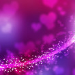Blurred purple sparkles and glowing line. Heart shapes. — Stock Photo