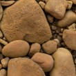 Stock Photo: Iron stained orange pebbles