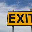 Yellow and Black Exit Sign against the sky — Stock Photo