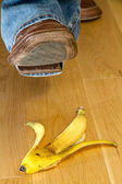 Foot about to tread on a banana skin — Stock Photo