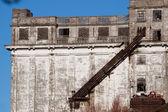 Facade of a derelict factory building — Stock Photo