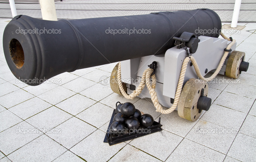 Old British naval canon on the streets of Portsmouth with seven canon balls  Stock Photo #11065964