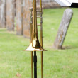 Trombone in a churchyard — Stock Photo